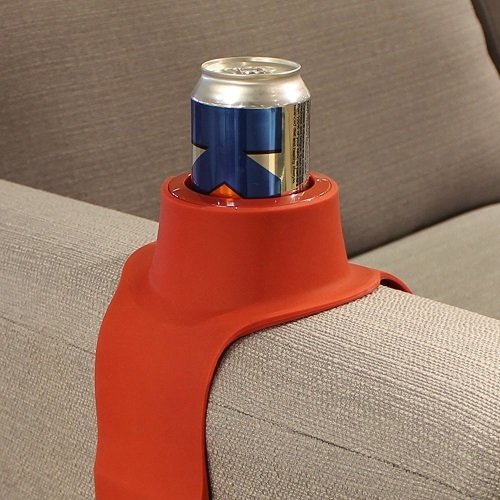 couch coaster holding a can
