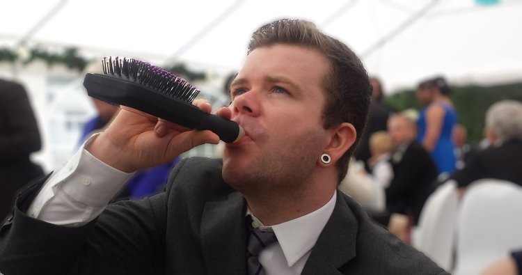 Drinking From Hairbrush Hip Flask